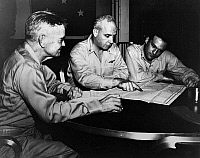 0216521 © Granger - Historical Picture ArchiveWWII: PHILIPPINE STRATEGY.   American Naval Admiral William Halsey (left) with two staff members, planning strategy for the Philippine campaign, on board a naval carrier. Photograph, c1942.