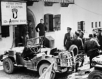 0216603 © Granger - Historical Picture ArchiveWORLD WAR II: STOLEN ART.   Allied soldiers at the entrance to a building where the stolen art collected by Hermann Goering during World War II was stored and displayed before being returned to its owners. Photograph, 1945.