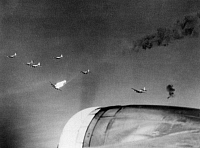 0216667 © Granger - Historical Picture ArchiveWORLD WAR II: B-17, c1943.   A formation of U.S. Air Force B-17 Flying Fortresses over Ruhland, Germany. The plane at the center has been hit and is enveloped in flames. Photograph, c1943.