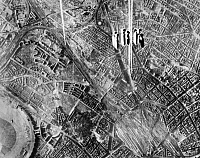 0216682 © Granger - Historical Picture ArchiveWORLD WAR II: BERLIN, 1945.   Bombs dropped from a U.S. Army 8th Air Force B-17 Flying Fortress over Berlin, Germany on 3 February 1945. At upper right is the Tempelhof Airdrome, upper center is Tempelhof rail yards.