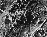 0216711 © Granger - Historical Picture ArchiveWORLD WAR II: BOMBING, 1945.   The railroad marshalling yards at Marburg, Germany, under attack by the 9th U.S. Air Force on 22 February 1945.