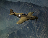 0216756 © Granger - Historical Picture ArchiveWWII: P-51 MUSTANG, 1942.   A P-51 Mustang fighter plane in flight over Inglewood, California. Photograph by Alfred T. Palmer, October 1942.
