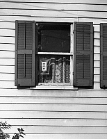 0216852 © Granger - Historical Picture ArchiveWWII: HOMEFRONT, 1943.   A service flag in the window of a home in Oswego, New York. Photograph by Marjory Collins, 1942.