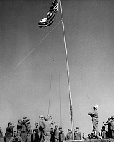 0259542 © Granger - Historical Picture ArchiveWORLD WAR II: IWO JIMA, 1945.   United States Marines saluting an American flag after the proclamation of occupation and declaration of suspension of Japanese authority is read in the Volcano Islands, Japan. Photograph, 14 March 1945.