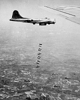 0259544 © Granger - Historical Picture ArchiveWWII: FLYING FORTRESS.   A Boeing B-17 'Flying Fortress' dropping bombs above Germany. Photograph, c1943.