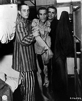 0323929 © Granger - Historical Picture ArchiveCONCENTRATION CAMP, 1945.   Men in a concentration camp at Flossenburg, Germany, discovered by 97th Division of the U.S. Army. Photograph, May 1945.