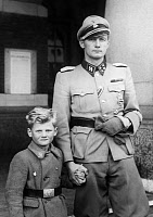 0324809 © Granger - Historical Picture ArchiveCHRISTIAN VON SCHALBURG   (1906-1942). Christian Frederik von Schalburg. Danish army officer and commander of the Free Corps Denmark. Photographed with his son, 1942.