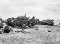 0371333 © Granger - Historical Picture ArchiveWWII: NORMANDY, 1944.   English medics attending to wounded English soldiers near a Churchill tank on Sword Beach during the Invasion of Normandy. Photograph, 6 June 1944. Full credit: Tallandier - Rue des Archives / Granger, NYC -- All rig