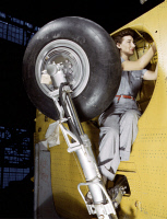 0408659 © Granger - Historical Picture ArchiveWWII: FACTORY, 1943.   A woman working on the wheel well of a Vultee A-31 Vengeance at the Vultee Aircraft plant in Nashville, Tennessee. Photograph by Alfred T. Palmer, 1943.