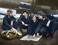 0408970 © Granger - Historical Picture ArchiveWWII: WOMEN PILOTS, c1941.   Four female pilots looking at a chart. Photograph, c1941, digitally colored by Granger, NYC -- All Rights Reserved.