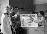 0410199 © Granger - Historical Picture ArchiveWORLD WAR II: FOOD, 1943.   Ida Lansden explains the necessity of preserving vitamins in available food during the shortage, Virginia. Photograph by Ann Rosener, March 1943.