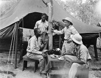 0527323 © Granger - Historical Picture ArchiveWWII: NEW GUINEA, 1943.   U.S. Army Chaplain Theodore R. Frierson meeting with American troops in New Guinea during World War II. Photograph, 1943.