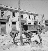 0527926 © Granger - Historical Picture ArchiveWWII: SICILY, 1943.   British and Italian soldiers working to restore communication facilities on the island of Sicily, following the evacuation of Axis forces. Photograph by Nick Parrino, 1943.