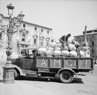 0527927 © Granger - Historical Picture ArchiveWWII: SICILY, 1943.   An Allied Military Government for Occupied Territories truck delivering flour to a bakery in Sicily, following the evacuation of Axis forces. Photograph by Nick Parrino, 1943.