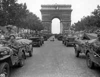 0527971 © Granger - Historical Picture ArchiveWWII: PARIS, 1944.   American jeeps of the 28th Infantry Division driving down the Avenue des Champs-Élysées in Paris, France. Photograph, 1944.