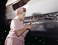 0528492 © Granger - Historical Picture ArchiveWWII: FACTORY, 1942.   A woman doing electrical assembly and installation on an aircraft at the Douglas Aircraft plant in Long Beach, California. Photograph by Alfred T. Palmer, October 1942.