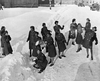 0528503 © Granger - Historical Picture ArchiveWWII: WOMEN'S ARMY CORPS.   Members of the United States Women's Army Corps playing in the snow at Camp Shanks in New York. Photograph, 1946.