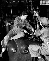 0528527 © Granger - Historical Picture ArchiveWOMEN MARINES, 1943.   Corporal Essie Lucas and Jean Ayers of the US Marine Corps Women's Reserve working on an engine at Camp Lejeune in North Carolina. Photograph, 1943.