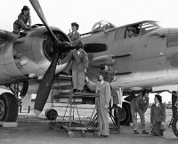 0528528 © Granger - Historical Picture ArchiveWOMEN MARINES, 1945.   A US Marine crew working on a B-25 Mitchell bomber at Marine Corps Air Station Cherry Point in North Carolina. Left to right: Thelma Martin, Ruth Dineau, Eunice Anderson, Selma Olson, Bettie Smith, Margaret Engwald, Carol Peters, Eleanor Moors, and Frances Culbranson. Photograph, 1945.