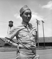0529050 © Granger - Historical Picture ArchiveJAPANESE INTERNMENT, 1942.   A Japanese American soldier in Florin, California, on furlough from the U.S. Army to help his family prepare to relocate to internment camps for the duration of the war. Photograph by Dorothea Lange, 10 May 1942.
