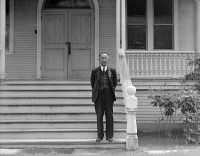 0529052 © Granger - Historical Picture ArchiveJAPANESE INTERNMENT, 1942.   Reverend Naito, a Buddhist priest, on the steps of his church in Florin, California, prior to being relocated to an internment camp for the duration of the war. Photograph by Dorothea Lange, 12 January 1942.