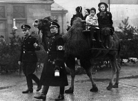 0620441 © Granger - Historical Picture ArchiveWWII: BERLIN, 1939.   War fundraiser in Wittenbergplatz, Berlin, with camel guided by SS officers. Photograph by Herbert Hoffmann, 5 November 1939. Full Credit: ullstein bild - Herbert Hoffmann / Granger, NYC. All Rights Reserved.