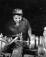 0621081 © Granger - Historical Picture ArchiveWWII: WORKER, c1945.   An African American woman operates a lathe in the machine shop at Phelp Vocational School, Washington, D.C. Photograph by Roger Smith, c1945.