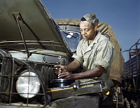 0621109 © Granger - Historical Picture ArchiveWWII: MECHANIC, 1942.   African American mechanic at work, Fort Knox, Kentucky. Photograph by Alfred T. Palmer, June 1942.
