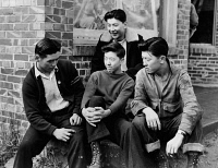 0621689 © Granger - Historical Picture ArchiveJAPANESE INTERNMENT, 1942.   Group of young Japanese Americans in Seattle, Washington, discussing their upcoming evacuaction to internment camps. Photograph, 1942.