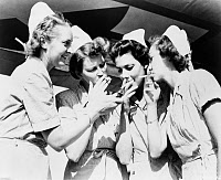 0621842 © Granger - Historical Picture ArchiveAIR FORCE NURSES, c1945.   A group of American nurses, stationed on a bomber base in Russia, sharing a lighter. Photograph, c1945.