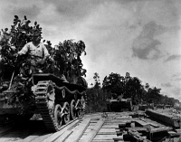 0622771 © Granger - Historical Picture ArchiveWWII: MALAYSIA, 1942.   Japanese tanks advance through marshland towards Johor Bahru in British Malaysia. Photograph, January 1942. Full Credit: Ullstein Bild / Granger, NYC. All Rights Reserved.