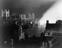 0622871 © Granger - Historical Picture ArchiveWWII: LONDON AIR RAID, c1941.   A records office in London, England burns following a German air raid. Photograph, c1941.