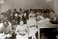0528040 © Granger - Historical Picture ArchiveWWI: RED CROSS, 1918.   Women and girls at an American Red Cross workroom in Jerusalem, sewing clothing for orphanages and hospitals in Palestine. Photograph, 1918.