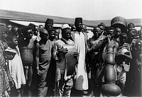 0124074 © Granger - Historical Picture ArchiveKENYA: MUSICIANS, c1907.   Public gathering around men with musical instruments in Mombasa, Kenya. Photographed c1907.