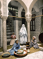 0168663 © Granger - Historical Picture ArchiveALGIERS: COUSCOUS, c1899.   Young Algerian women preparing couscous in a courtyard at the Luce Ben-Aben workshop in Algiers. Photochrome, c1899.
