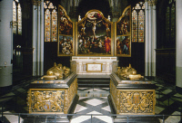 0322675 © Granger - Historical Picture ArchiveBRUGES: CHURCH OF OUR LADY.   Gilt bronze and black marble tombs of Duchess Mary of Burgundy (left) and her father, Charles the Bold, before the high altar in the Church of Our Lady, Bruges, Belgium. The triptych altarpiece features crucifixion scenes painted by Bernard van Orley, Marcus Gheeraerts the Elder, and Frans Pourbus the Younger, 16th century.