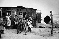 0175220 © Granger - Historical Picture ArchivePEACE CORPS: BRAZIL.   A family standing outside their home in a favela in Rio de Janeiro, Brazil. Photograph, c1965.