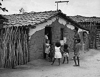0175229 © Granger - Historical Picture ArchivePEACE CORPS: BRAZIL.   Peace Corps volunteer Marilyn Downing with villagers in Pombal, Brazil. Photograph, c1965.