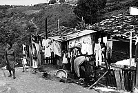 0176465 © Granger - Historical Picture ArchiveBRAZIL: HOMES, c1970.   A family outside their shack in Brazil. Photograph, c1970.