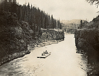0128425 © Granger - Historical Picture ArchiveYUKON: MILES CANYON, 1897.   Flatboatmen passing through Miles Canyon on the Lewis (Lewes) River, or Yukon River, in the Yukon Territory, Canada. Photographed by F.D. Fujiwara, 1897.