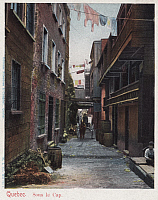 0323870 © Granger - Historical Picture ArchiveQUEBEC: MONTREAL.   An alley in Montreal, Quebec, Canada. Photo postcard, late 19th or early 20th century.