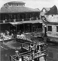 0113944 © Granger - Historical Picture ArchiveCHINA: SHANGHAI, 1900.   A typical footbridge and buildings in Shanghai, China. Stereograph, 26 October 1900.