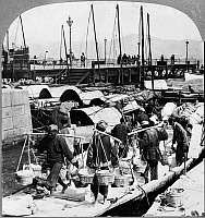 0116353 © Granger - Historical Picture ArchiveCHINA: HONG KONG, c1902.   Dock workers on the busy wharfs at Hong Kong, c1902. Stereograph, c1902.