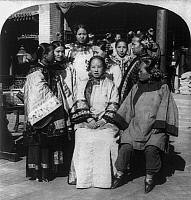 0117514 © Granger - Historical Picture ArchiveCHINA: PEKING, c1902.   A group of Pekingese women in traditional dress in the court of a Chinese mansion, Peking, China. Stereograph, c1902.