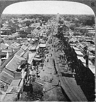 0121464 © Granger - Historical Picture ArchiveCHINA: PEKING, c1905.   View of a busy thoroughfare in Peking, China, looking west from the Drum Tower. Stereograph, c1905.
