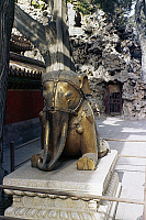 0121687 © Granger - Historical Picture ArchivePEKING: ELEPHANT.   Bronze sculpture of a kneeling elephant in a garden of the Forbidden City, Peking, China. Photographed c1970.