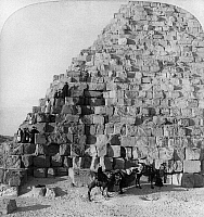 0115570 © Granger - Historical Picture ArchiveEGYPT: CHEOPS PYRAMID.   Group of tourists with guides on camels, climbing the Cheops Pyramid at Giza, Egypt. Stereograph, c1896.