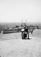 0120129 © Granger - Historical Picture ArchiveEGYPT: CAIRO, c1936.   A view of the city of Cairo from the Mokattam Hills, with a man and his donkey in the forground. Photograph, c1936.