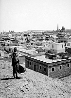 0120166 © Granger - Historical Picture ArchiveEGYPT: CAIRO.   A view of the City of the Dead with a man standing in the foreground in Cairo, Egypt. Stereograph, early 20th century.