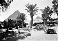 0120524 © Granger - Historical Picture ArchiveEGYPT: CAIRO.   The front garden of The Mena House hotel with two pyramids in the background, Cairo, Egypt. Photograph, c1935.